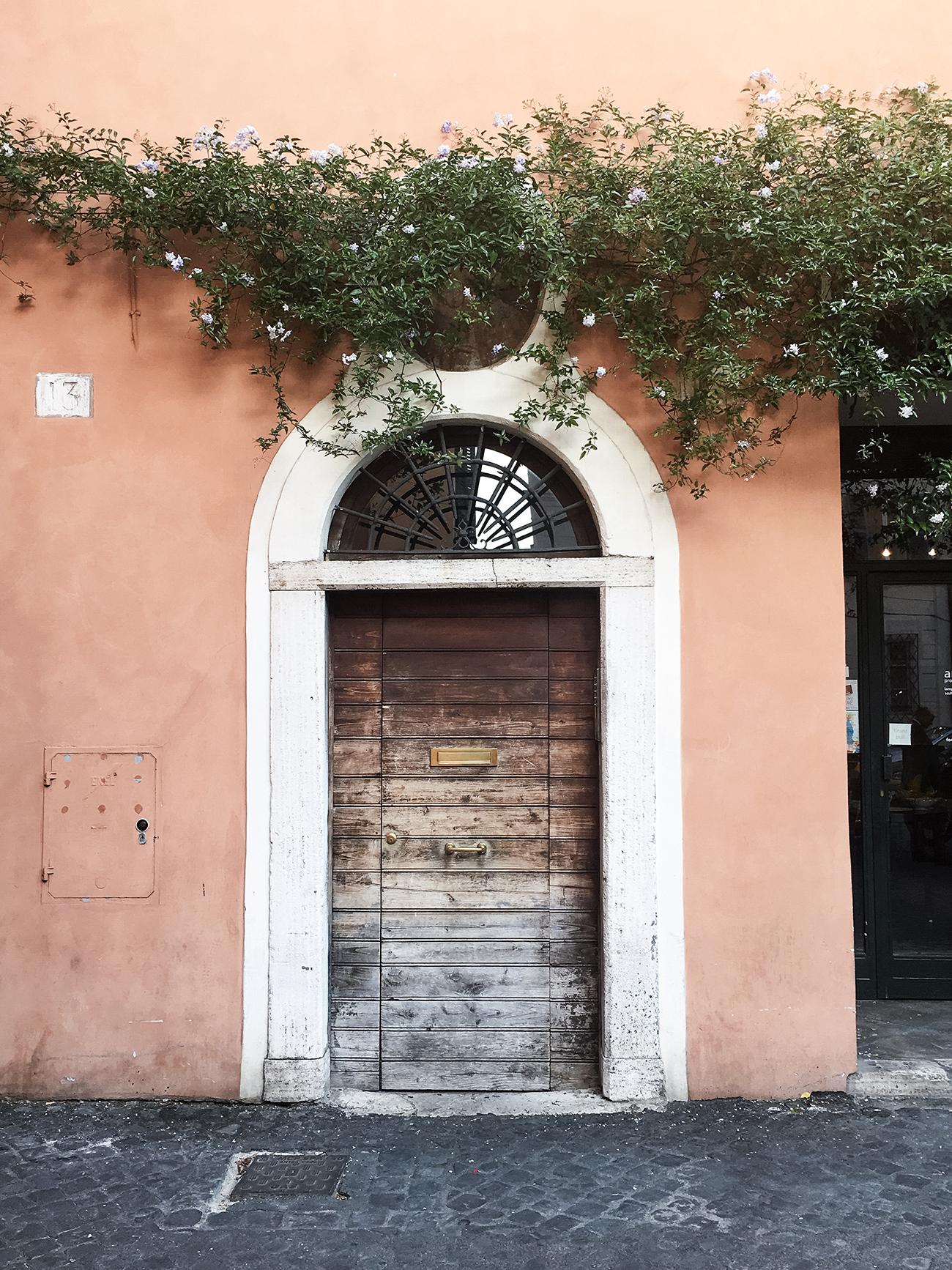mademoiselle travels rome italy doorway