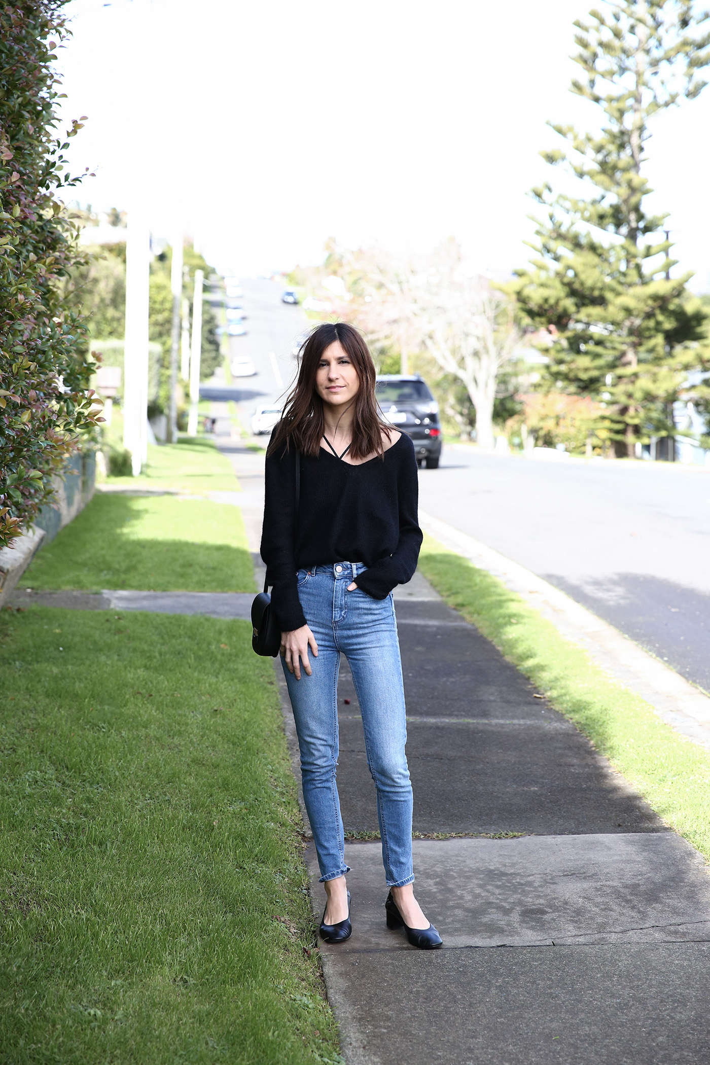 minimal outfit wearing sweater and jeans